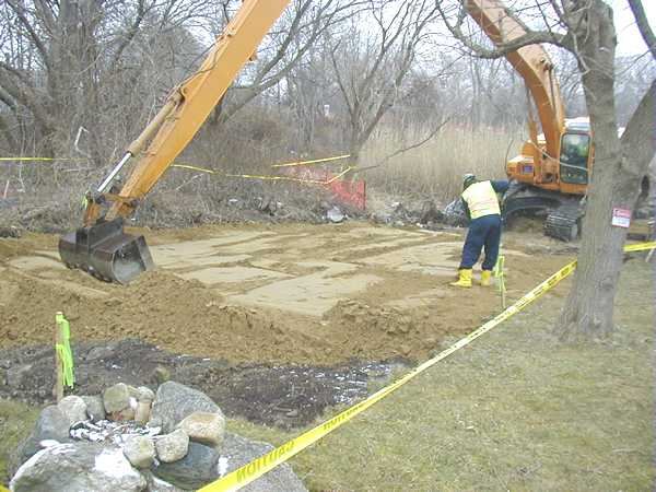 March 2001, Placing clean soil in an excavated backyard