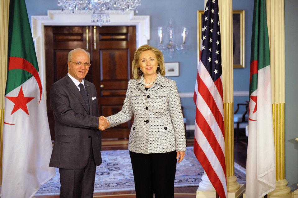 Secretary Clinton Shakes Hands With Algerian Foreign Minister Medelci