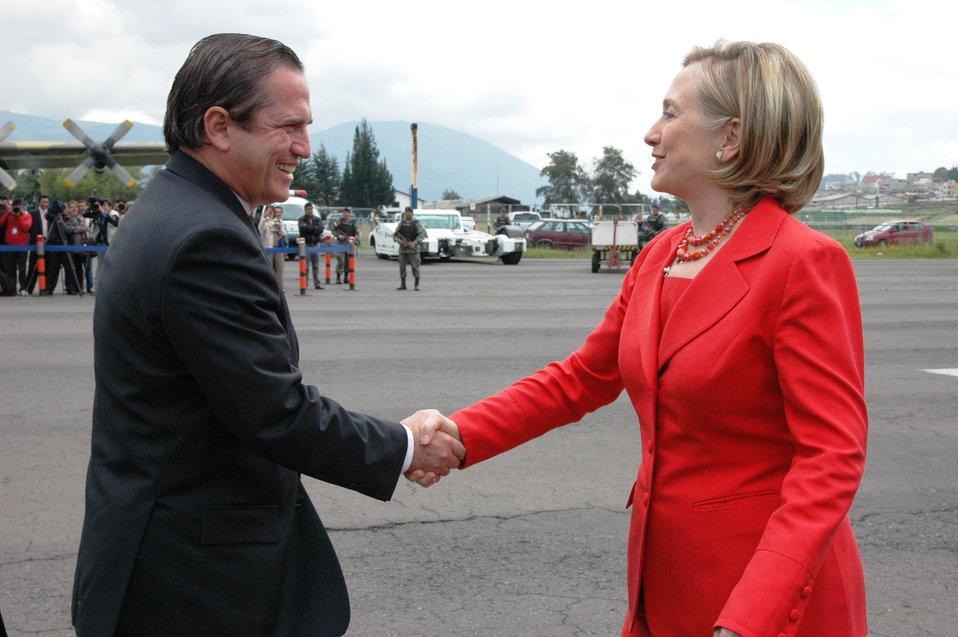 Secretary Clinton Is Greeted By Ecuadorian Foreign Minister Ricardo Patiño
