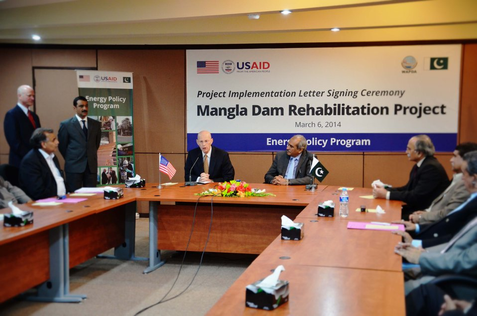 USAID Mission Director speaking at the signing ceremony