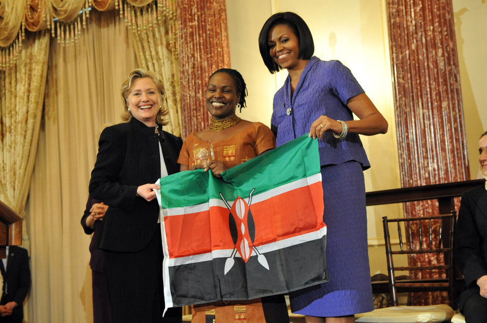 Secretary Clinton Shakes Hands With Honoree Ann Njogue