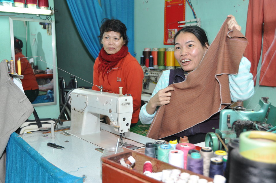 Le Thi Het receives support to boost her income from sewing.