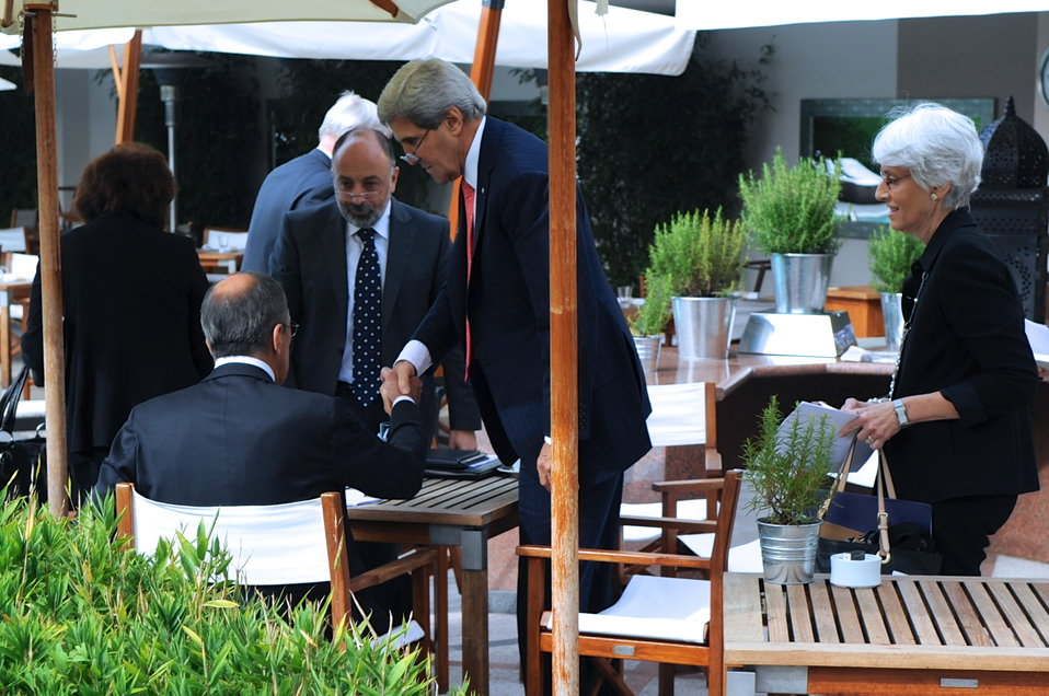 Secretary Kerry and Russian Foreign Minister Lavrov Shake Hands After Reaching an Agreement on Syria