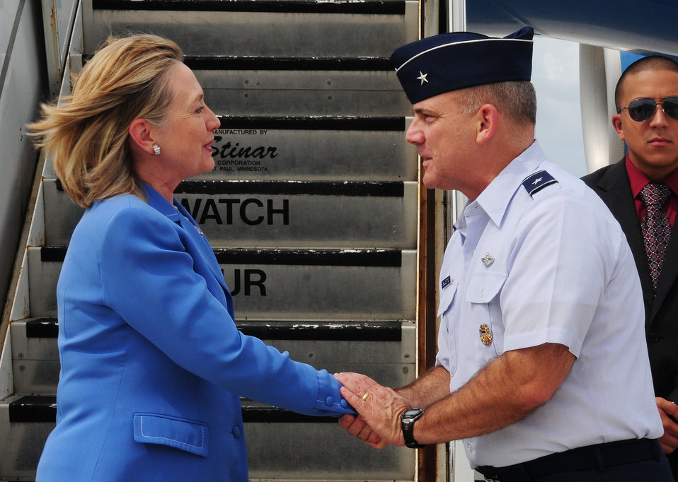 Secretary Clinton Is Greeted By Brig. Gen. Doucette