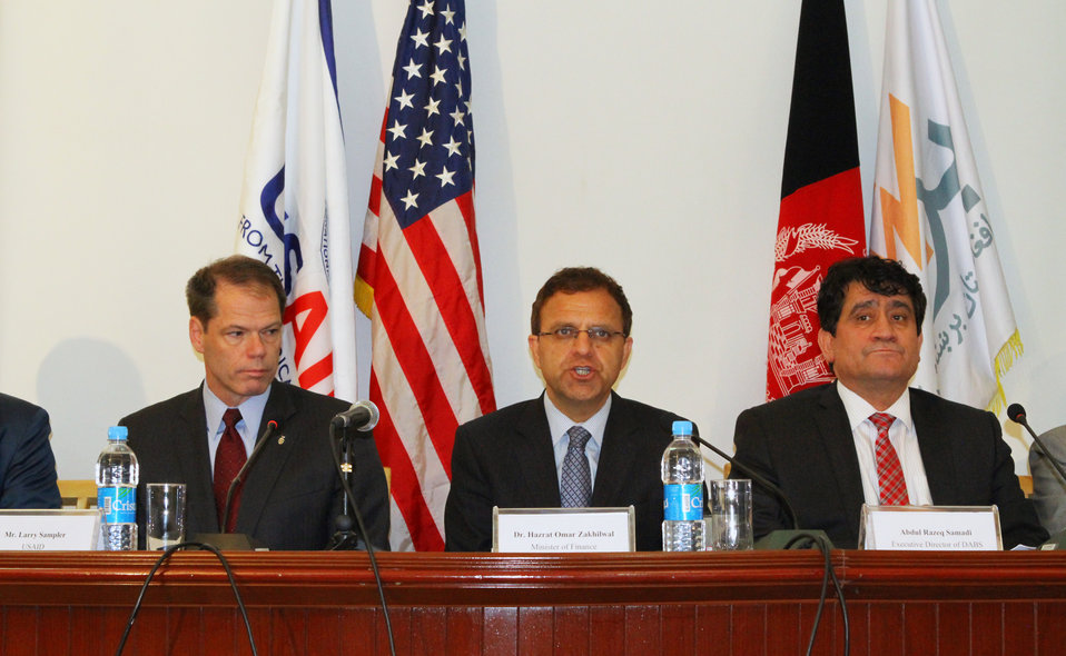 (L-R) USAID Assistant to the Administrator for Afghanistan and Pakistan Affairs Larry Sampler, Afghan Finance Minister Omar Zakhilwal and DABS CEO Abdul Razique Samadi attend contract signing ceremony in Kabul.