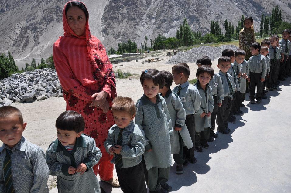 School children at Gulmit gathered to welcome Deputy Director Karen Freeman (USAID)