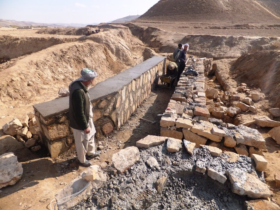 Laborers working to construct a culvert in Zadsaleh village in Qadis District