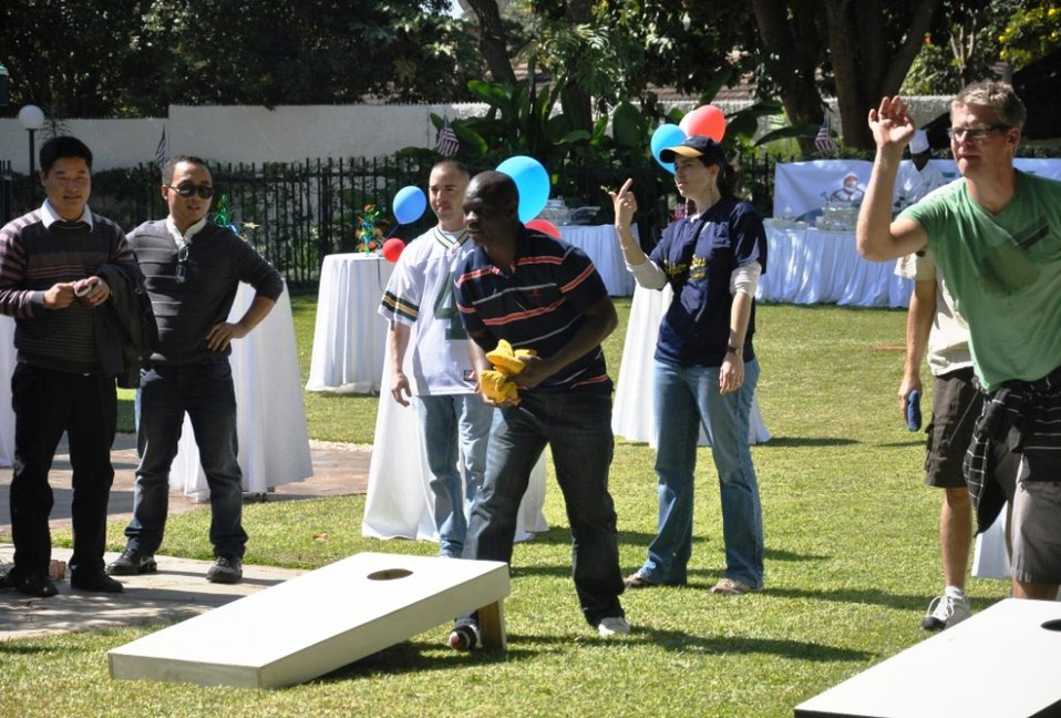 Americans and Zambians Compete in a Bean Bag Toss Contest