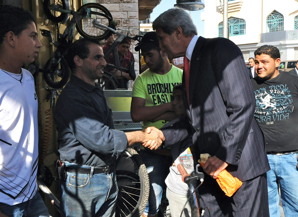 Secretary Kerry Greets a Shopkeeper in Ramallah