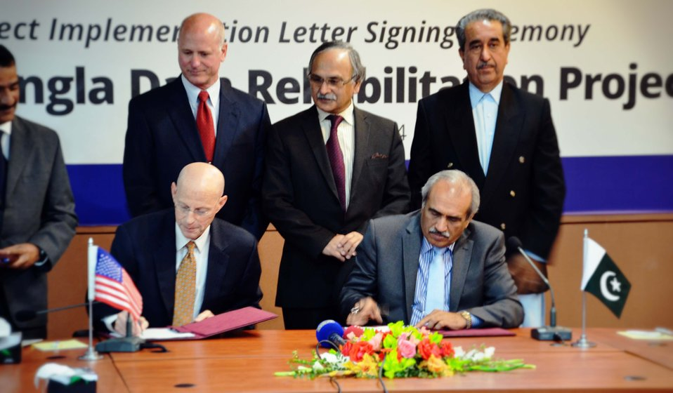 USAID Mission Director, Gregory Gottlieb and Chairman WAPDA, Syed Raghib Abbas Shah signing the implementation letter for rehabilitation of Mangla hydel power station
