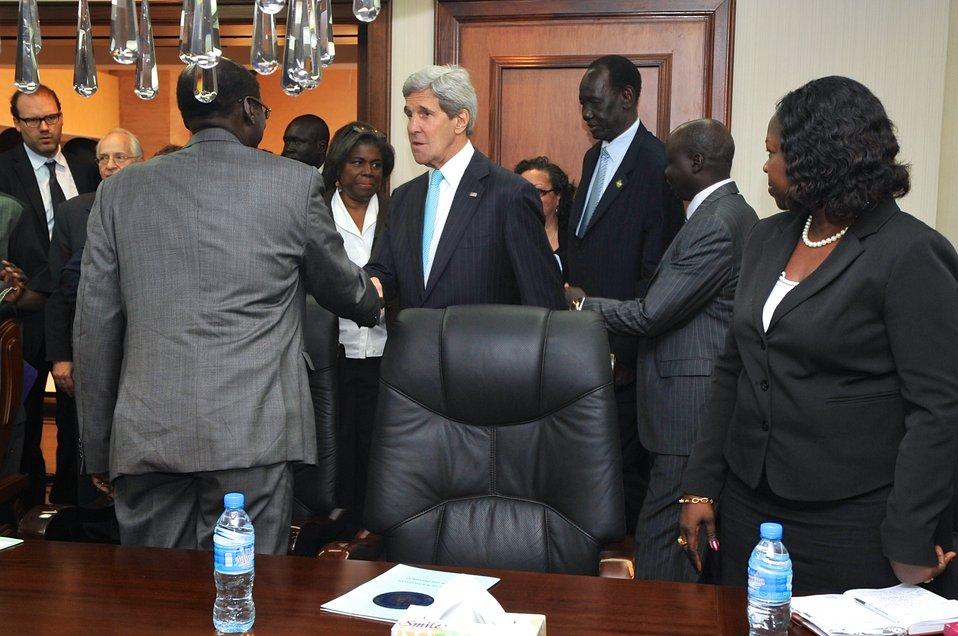 Secretary Kerry is Greeted by Members of South Sudanese President Kiir's Staff Before Meeting in Juba