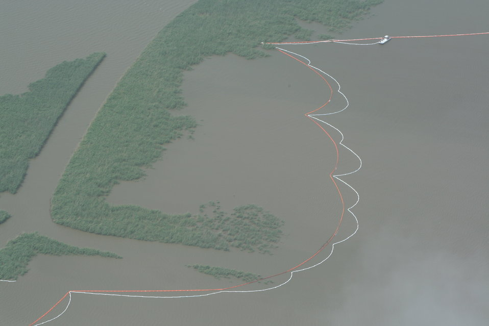 Oil booms protecting marshland