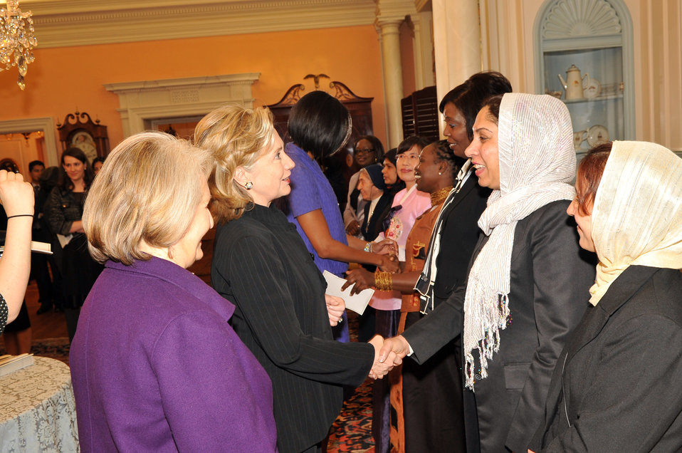 Secretary Clinton Shakes Hands With Honoree Colonel Shafiqa Quraishi of Afghanistan