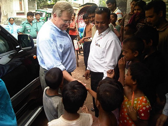 Assistant Secretary Schwartz Is Greeted By Children in Geneva Camp