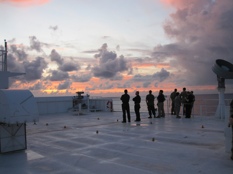 Military Personnel Stand on the Military Sealift Command hospital ship USNS Mercy's Deck