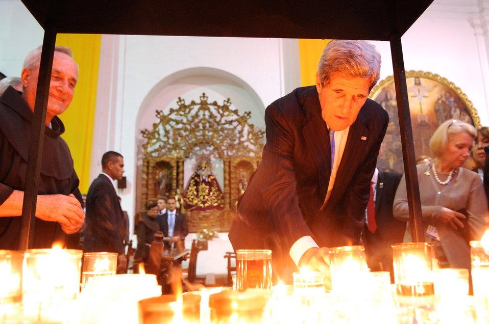 Secretary Kerry Lights a Prayer Candle