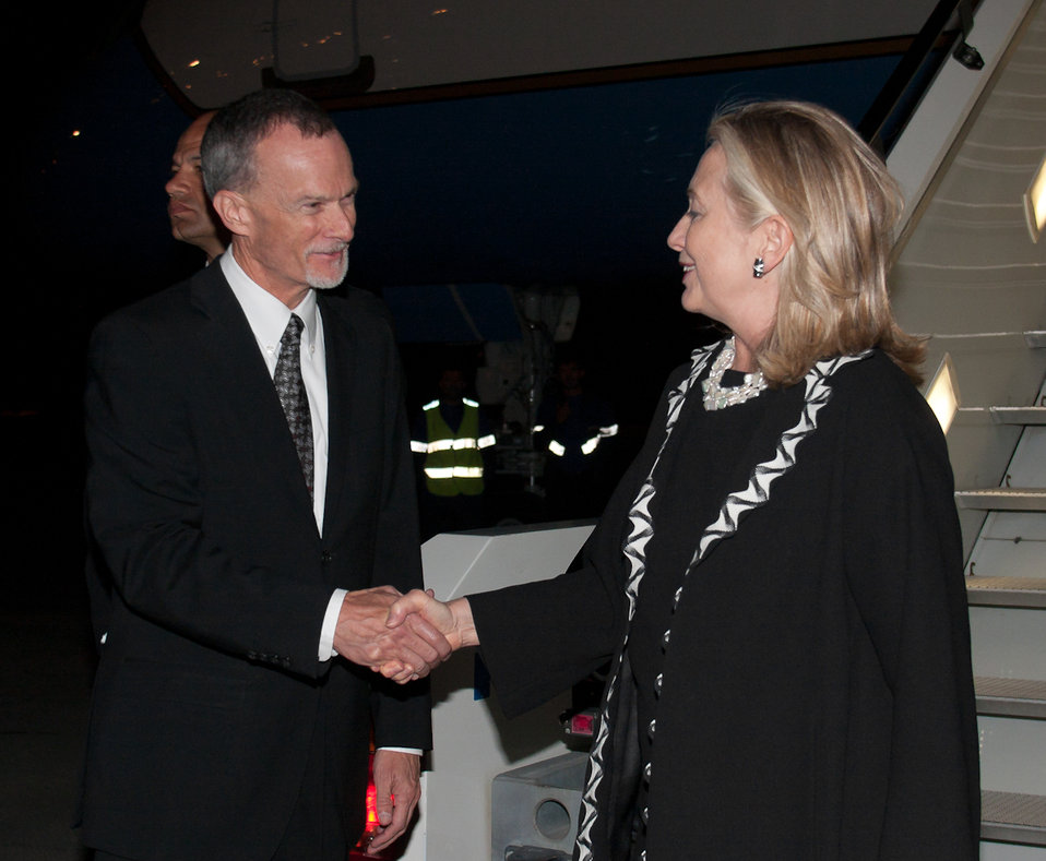 Secretary Clinton Is Greeted By Ambassador Gross