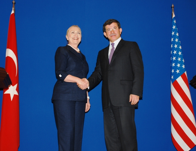 Secretary Clinton Shakes Hands With Turkish Foreign Minister Davutoglu