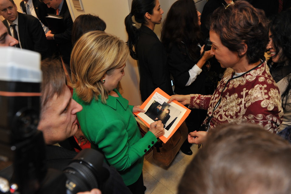 Secretary Clinton Signs a Photo for Public Affairs Assistant Muradova