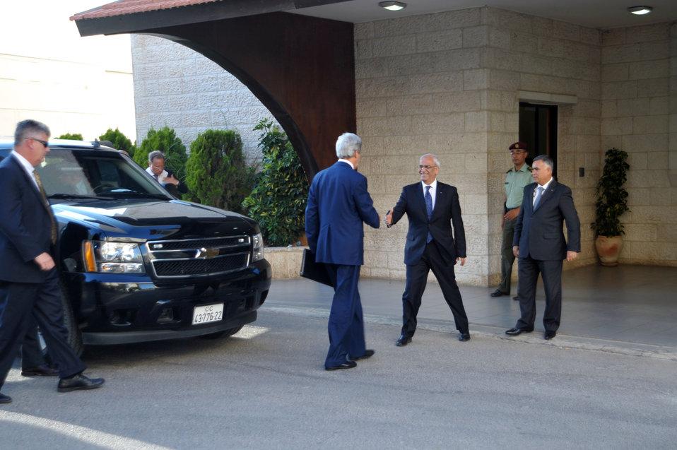 Secretary Kerry Is Greeted By Palestinian Authority Negotiator Erekat