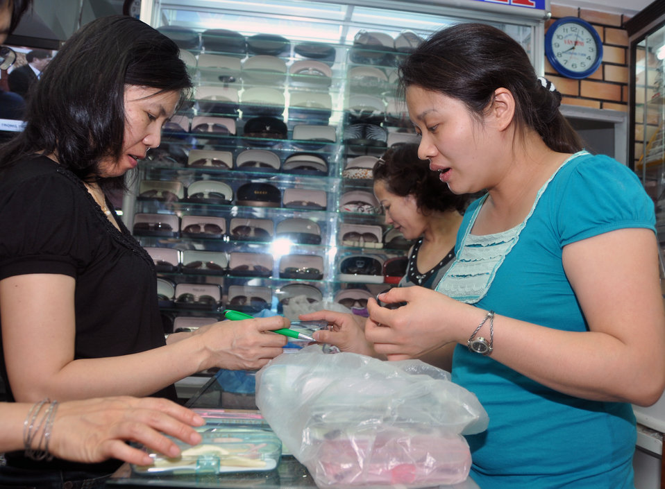 An eyeglasses specialist from the National Eye Hospital checks the quality of new glasses for students in Kon Tum.