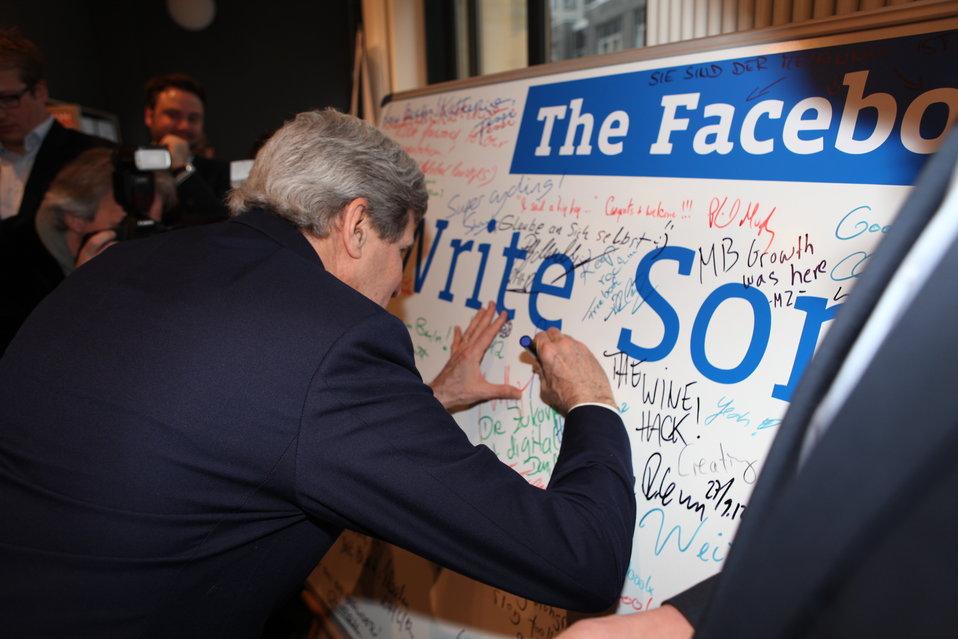 Secretary Kerry Signs a Facebook Wall