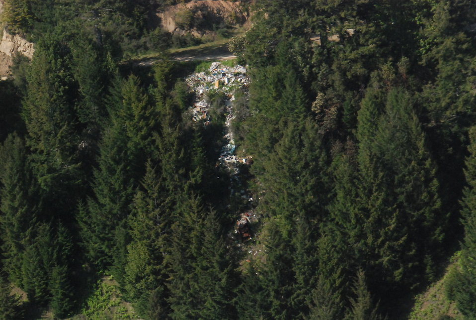Garbage illegally dumped approximately 2,500 feet above Mettah Creek