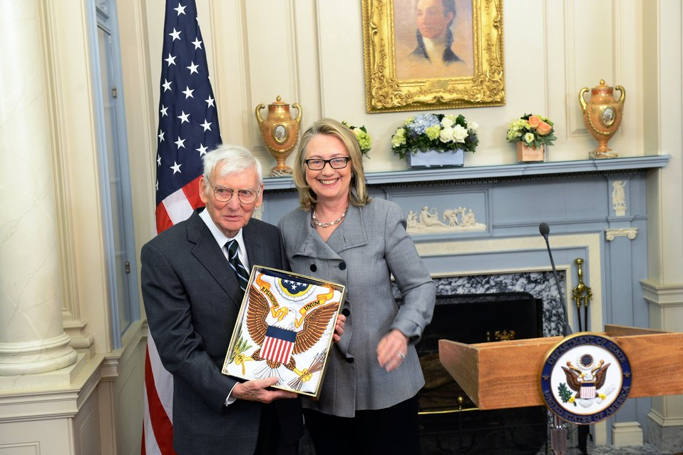 Secretary Clinton Poses for a Photo With Ambassador Rooney