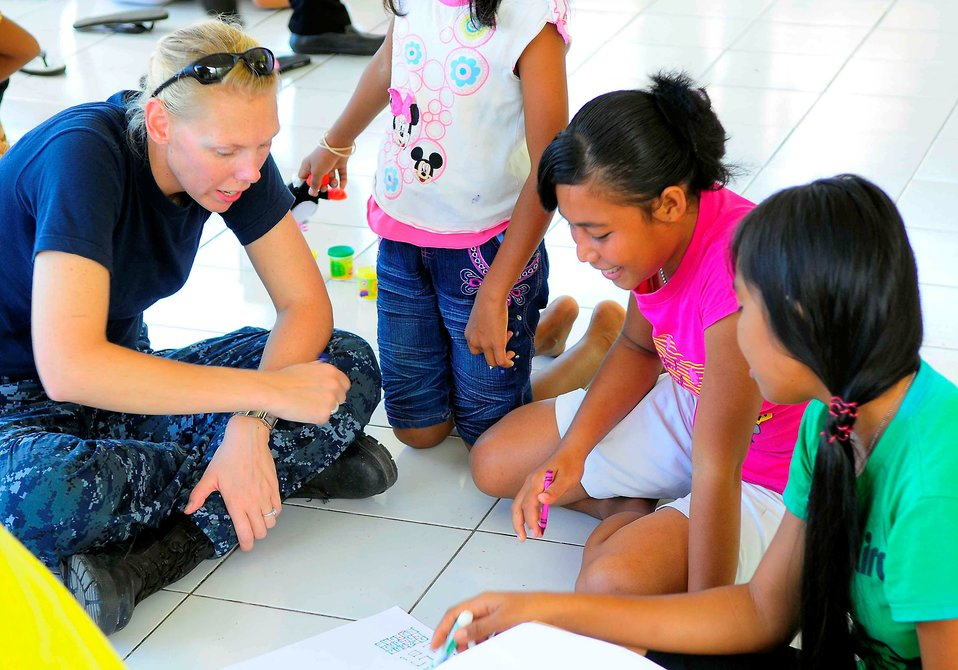 Religious Programs Specialist 1st Class Jennifer Snow Colors With Indonesian Girls