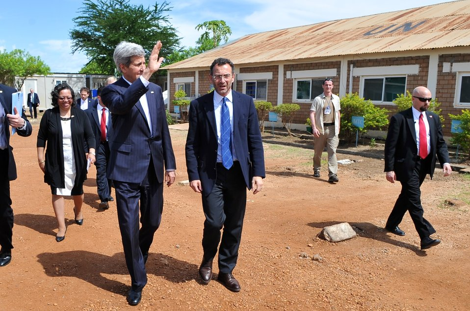 Secretary Kerry Waves As He Walks Through UNMISS Camp in Juba