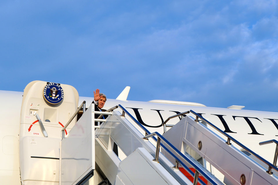 Secretary Kerry Waves Before Traveling to South America