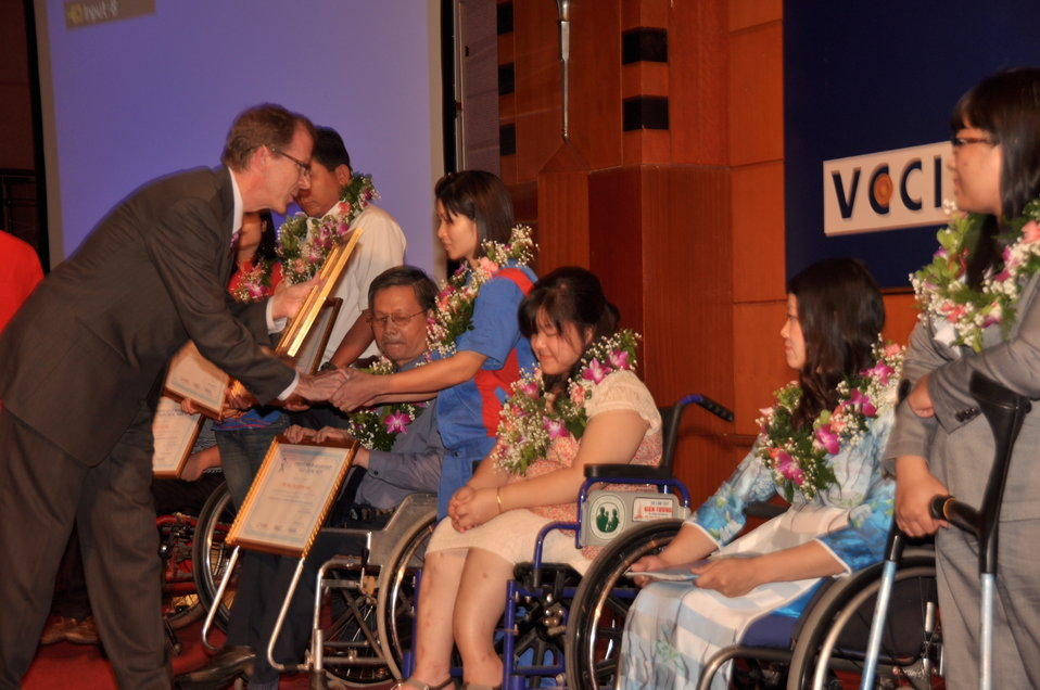 USAID Mission Director Joakim Parker awards employees with disabilities 1114
