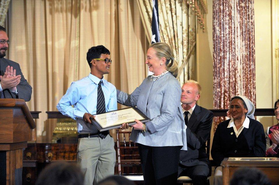 Secretary Clinton With TIP Hero Vannak Anan Prum