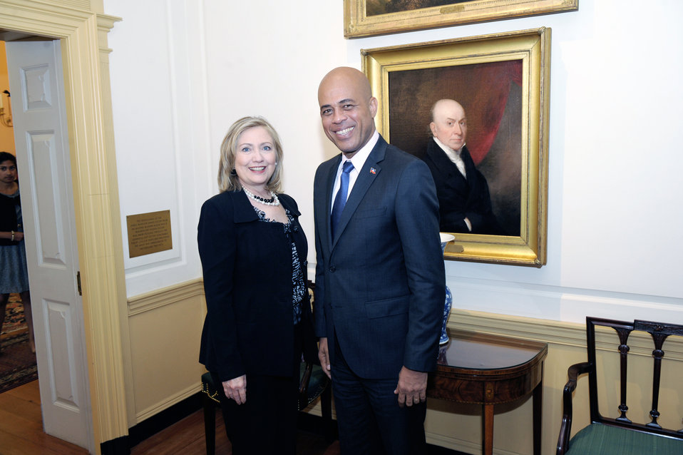 Secretary Clinton Poses for a Photo With Haitian President-Elect Martelly