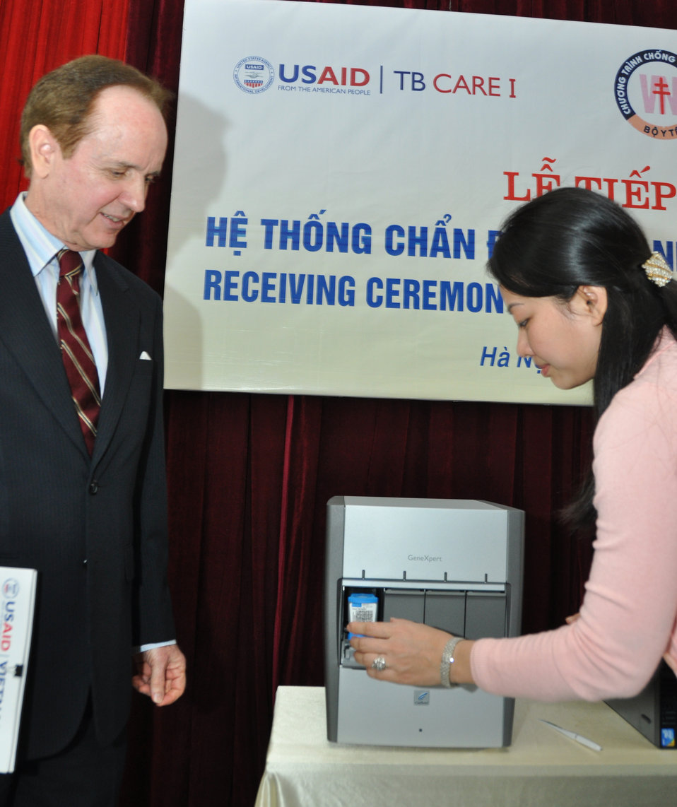 USAID Mission Director Francis Donovan learns how the equipment functions