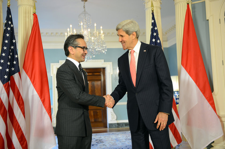 Secretary Kerry Shakes Hands With Indonesian Foreign Minister Natalegawa