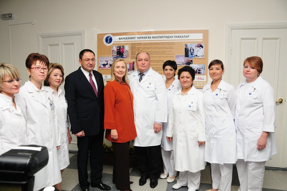 Secretary Clinton Poses for a Photo With Uzbek Health Minister, Dr. Dilmurod, and Wellness Center Staff