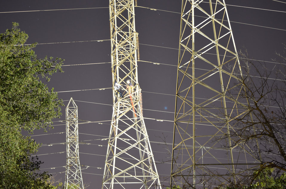 Workers from Western Area Power Administration de-energize high power lines