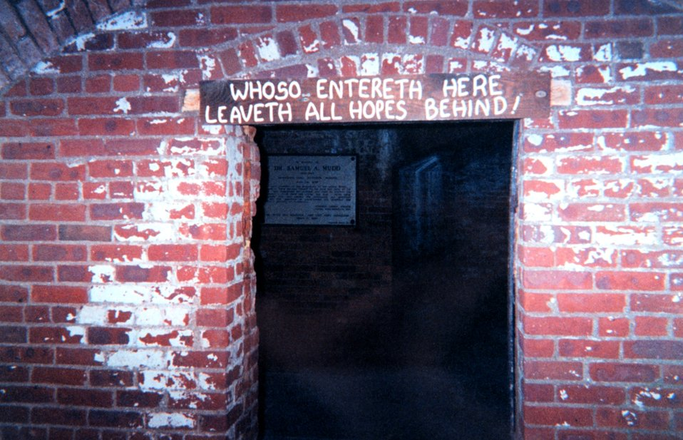 Sign over the cell that housed Dr. Samuel Mudd, controversial doctor who treated John Wilkes Booth following Abraham Lincoln's assassination.  Mudd was convicted of helping Booth and served three years of his sentence at Fort Jefferson.  He helped treat