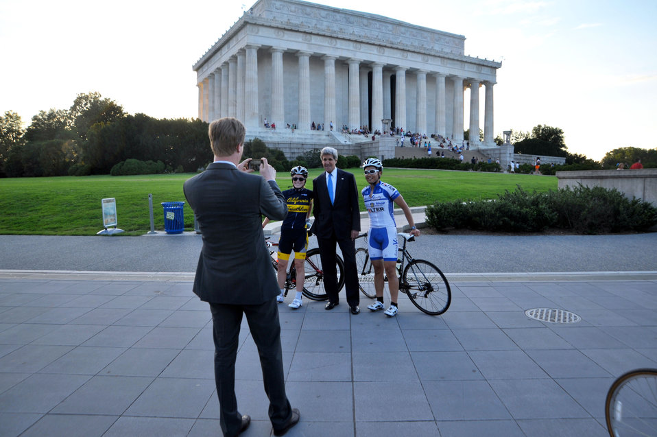 Secretary Kerry Poses for a Photo With Cyclists