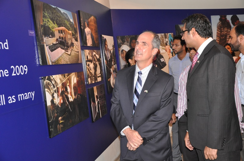 Provinicial Mission Director Punjab Ted Gehr and USAID team lookingat the photos on display