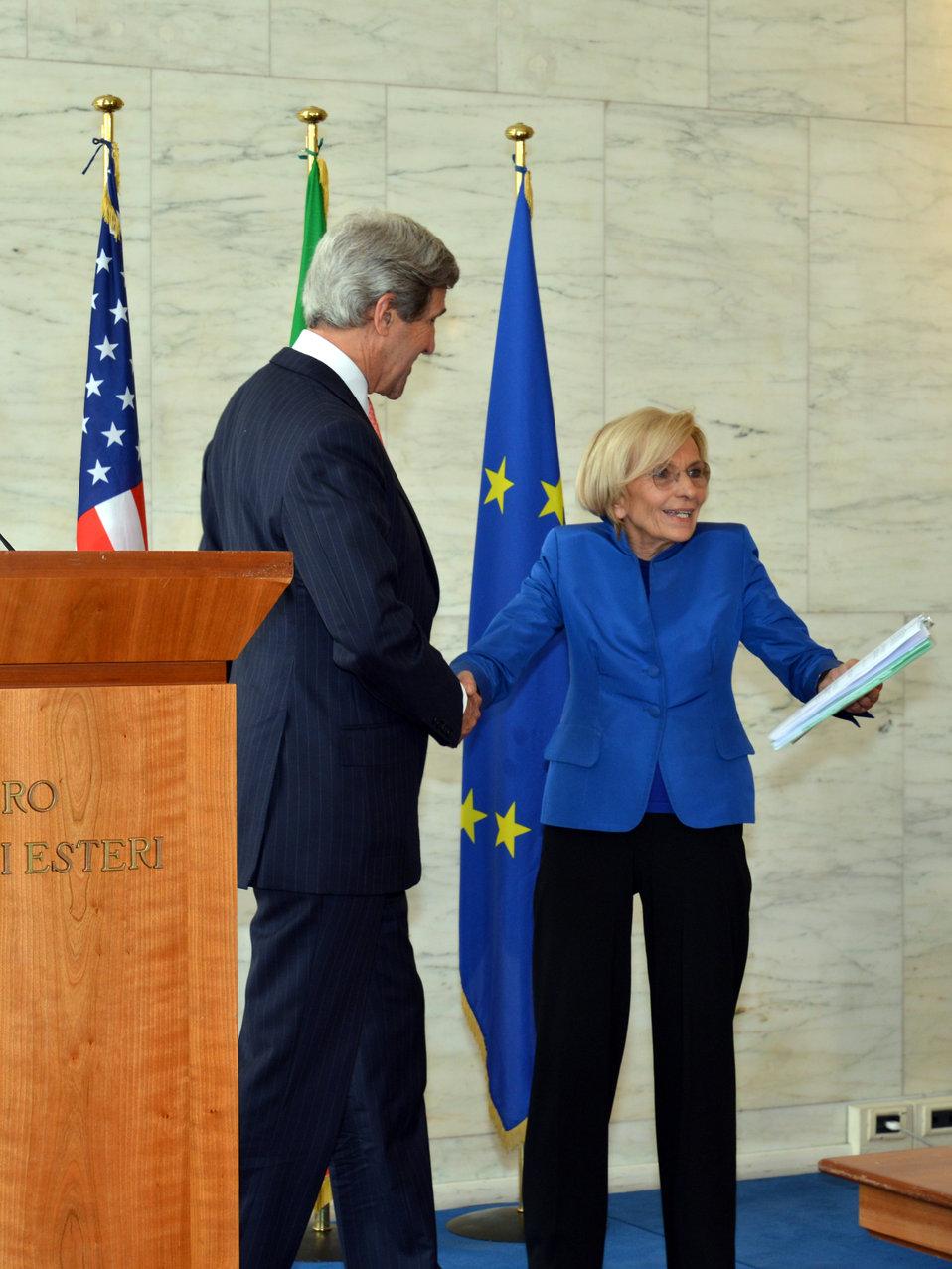 Secretary Kerry and Italian Foreign Minister Bonino Shake Hands