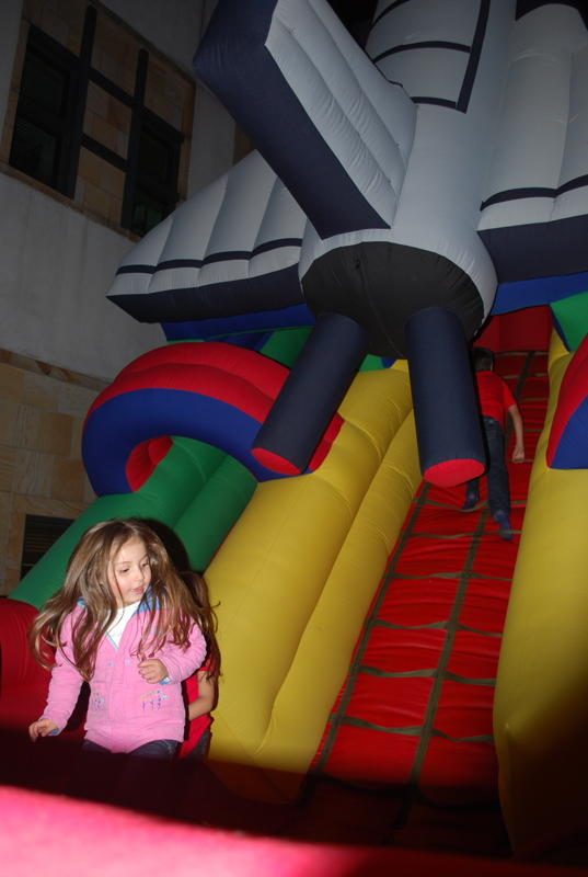 A Young Girl Celebrates the Fourth of July By Jumping a Space Shuttle Jumping Castle