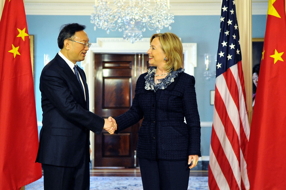 Secretary Clinton Shakes Hands With Chinese Foreign Minister Yang