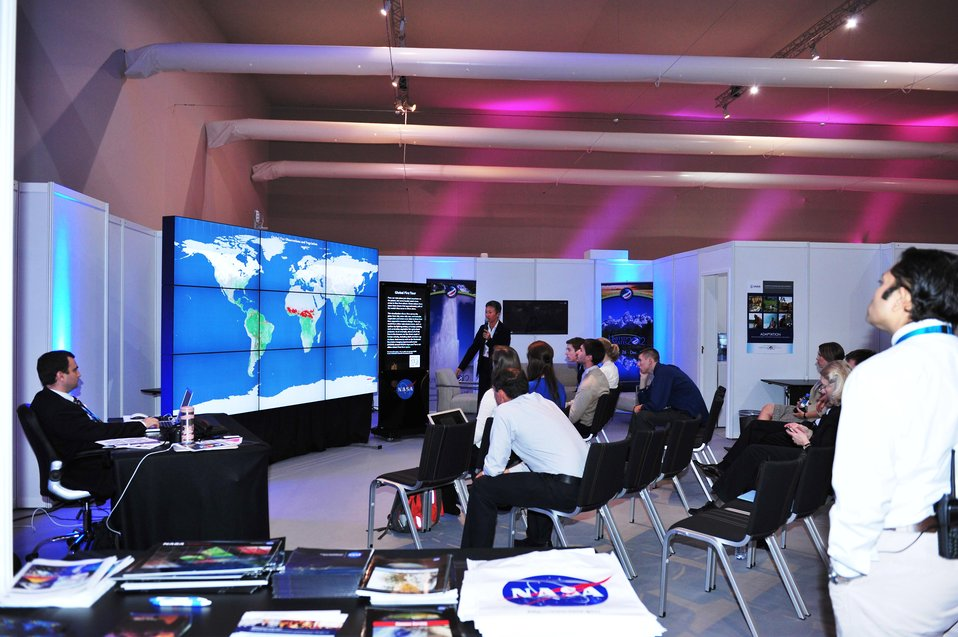 Visitors View Data Visualizations at the U.S. Center