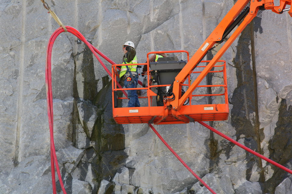 Installing electrical lines at the Folsom Dam auxiliary spillway
