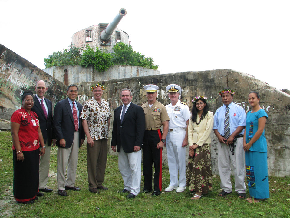 "Assistant Secretary Campbell, Kiribati Foreign Secretary Lambourne, and Other Officials Pose for a Photo at the Vickers 8"" Guns"