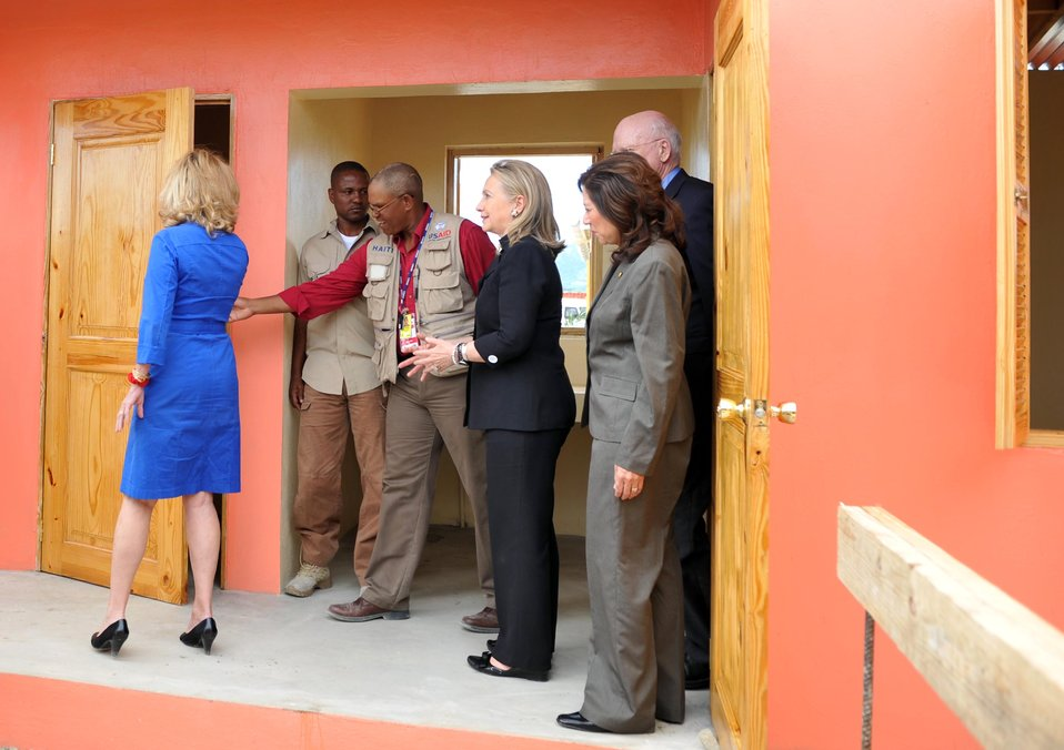 USAID/Haiti Engineer Nicoleau Shows Secretary Clinton the USAID-Funded Housing