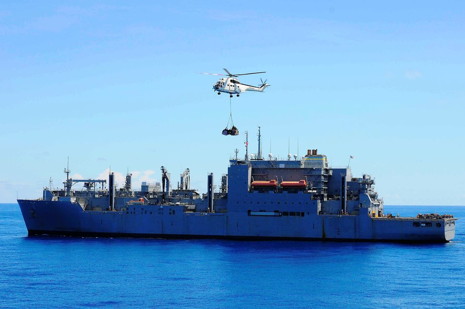 A Puma Helicopter Transports Cargo from USNS Richard E. Byrd to USNS Mercy