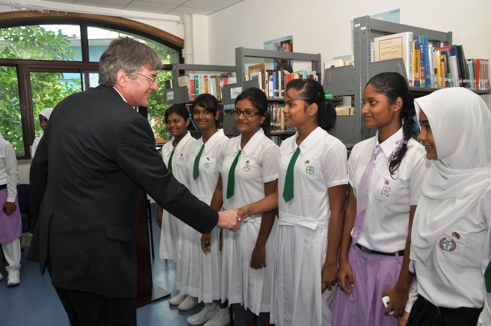 Deputy Secretary Steinberg Shakes Hands With a Maldivian Girls Soccer Team